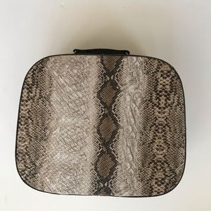 Handbags - Faux animal print cosmetic makeup case